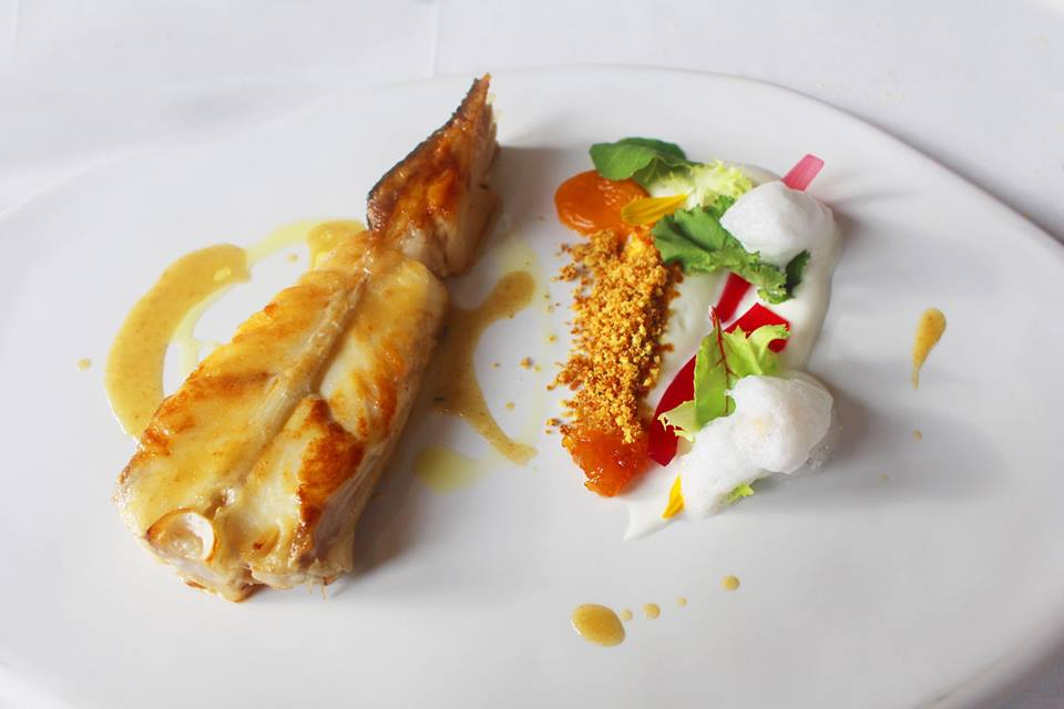 Slice of turbot, apricots, curry and onions in vinegar, greek yogurt sauce Da Vittorio Restaurant Brusaporto